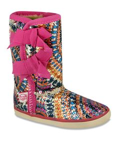 Pump up any look with these sequin studded boots. The faux fur lining and low-slung silhouette guarantee cozy comfort all day long.11.5'' shaft15'' circumferenceSample size 9Tie closureFabric upperFaux fur lining<...