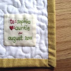 Hand embroidered quilt label.