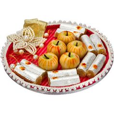 Rakhi Bandhan :  Cane thaali covered with rich velvet fabric and embelisjed with string of pearls and adorned with flower of pearls. This pack contains: Kaju apple. Net weight: 100 grams. Kaju roll. Net weight: 100 grams. Comes with rakhi, roli and chawal. Rs 644/- Shop Now : http://www.tajonline.com/rakhi-gifts/product/r4529/rakhi-bandhan/?aff=pint2014/