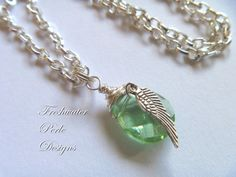 Angel Wing And Peridot Necklace by freshwaterperle on Etsy
