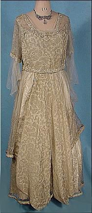 c. 1917 Evening Gown of Ivory and Platinum/Gold Metallic Brocade with Embroidered Net and Crystal Beading. Front