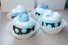 Delicioius Diaper Cupcake...  This listing is for 4 Servings of Diaper Cupcakes:Baby Ingredients are:(4) Baby diaper, size 1(4) Pair of warm baby socks(4) Soft baby washcloth(1) Coordinating Diaper Cupcake Bakery Box(1)