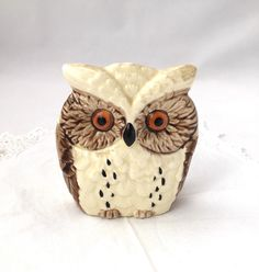 A personal favorite from my Etsy shop https://www.etsy.com/ca/listing/254845563/owl-napkin-holder-ceramic-owl-napkin-or