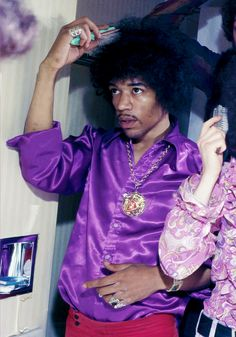 Jimi Hendrix working on his look in a mirror in London, 1968.