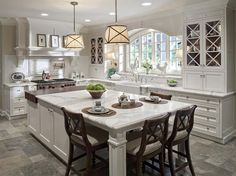 The size of this island and its layout! And those windows!  Butcher block and stone island