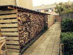 Houthok firewood woodshed woodstorage winter firewoodstorage storage wood woodpile pile of wood fire stove.