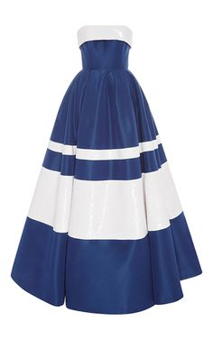 This **Carolina Herrera** ball gown features a contrasting foldover at the strapless neckline and a full floor length skirt.