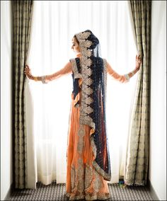 Peach and navy blue are the perfect hues for this stunning Pakistani bridal ensemble! The bride shines on her big day. #muslimbride #pakistanibride via Jamie Howell Photography