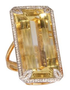 A half-white, half-yellow 60-carat citrine surrounded by diamond pave set on 18k gold by Parulina.