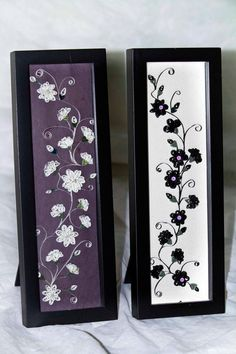 Love this negative and positive image of framed flowers done in quilling!