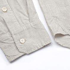 The West is Dead- Half Placket Oxford-Fall 2012 www.thewestisdead... Vintage inspired, half placket oxford shirt. Slim fitting, lightweight, closed with real bone buttons. Reverse box pleat on center back, triangle inserts on side vents, Fits true to size. See lookbook for fit photos Made in the USA.