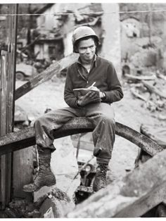 Cartoonist Bill Mauldin, in Typical WWII Gi Garb, Sketching Amidst Bombed-Out Bldgs