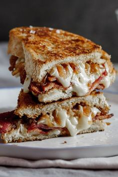 Crispy bacon & brie grilled cheese sandwich with caramelized onions.