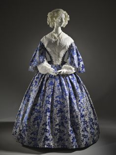 Dress: 1855, French, silk plain weave with supplementary weft-float patterning, silk satin, and silk-ribbon trim.