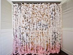 """Color us impressed by Esther Kim's DIY petal curtain, above. Esther says, """"I made this petal curtain as the backdrop for my wedding. I used by Gub Gub"""