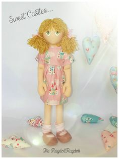 Beautiful handmade one of a kind rag doll  Sweet Castle Rags... This beautiful girl is a sheer delight... She is such a sweet little girl with blonde hair in bunches tied back with pink gingham ribbons, she has big green eyes. Her dress is pink with lovely princess castles. she wears pale pink fally down socks with little dusky pink shoes   All of our dolls are beautifully hand crafted, completely unique members of the ever expanding RagdollRagdoll family. Measuring approximately 18 inches…