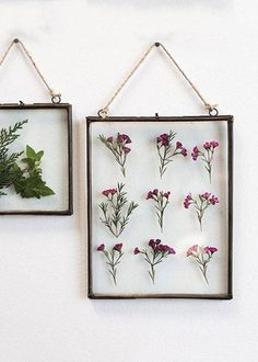 Use beautiful, premium silk flowers from Afloral.com to fill the glass insert of this hanging specimen metal wall frame to create a custom design. Then display as wall art.