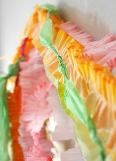 DIY crepe paper photo wall.  Links to dye and make all these crepe paper garlands and tissue paper tassels.