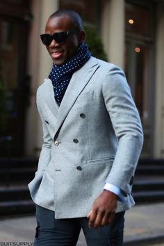 Wool sport coat, double breasted. Blue polka dot scarf. Well done.