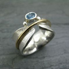 Custom Bodhi Leaf Spinner Ring with Aquamarine by StonesThrowStudio, via Flickr