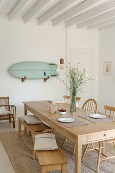 rustic modern dining room with mint green surf board wall decor and beamed ceili.rustic modern dining room with mint green surf board wall decor and beamed ceili.Home Wall Ideas Dining Room Walls, Dining Room Sets, Dining Room Design, Modern Dining Rooms, Dining Area, Light Wood Dining Table, Beach Dining Room, Living Room, Dining Room Bench