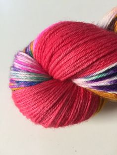 Welcome our new base: Costello Smooth Sock. This base is exclusive to the monthly colorways. This base is quite springy, very soft, and durable. Perfect for on your feet, around your face, basically anywhere! It's become a new favorite to knit with. Meet February's colorway: Lunar Sheep. Inspired by the Lunar New Year, your skein will have a splash of colors reminiscent of fireworks and a big chunk of red to mimic the envelopes I received every year as a child.  With this colorway you'll ...
