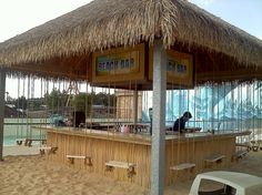 beach bar with swings