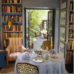 dining in my dream library--lavender, books and animal print with French doors--John Stefanidis...