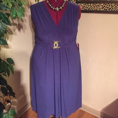 "Purple Cocktail Dress New, never worn with tags attached. Purple, v-neck, Empire waist cocktail dress. Almost mid calf on me at 5'6"". Very nice quality soft material with decorative silver clasp. Very elegant. Kupcake Dresses Midi"