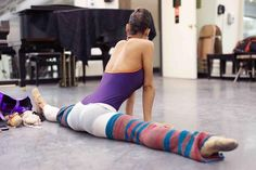Misty Copeland stretching before company class at the ABT studios. Photo by Jim Lafferty.