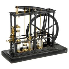 """1 - Physical Demonstration Model of a James Watt Type Beam Steam Engine, c. 1850 Early engineering model of a low-pressure beam engine with double-action cylinder. Manufactured by """"Eugène Bourdon, Paris"""", a very rare version with glass cylinders, brass precision parts, cast-iron frame, pillars, beam and flywheel, on wooden base, overall size 34 x 13 1/3 x 26 3/4 in.! Flywheel Ø 21 1/4 in. - The machine is complete with slide valve control, condenser with vaporizer, vacuum pump, water flap…"""
