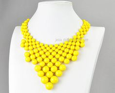 Yellow Beads $12.99, via Etsy. Seriously loooove this site. dangerous!