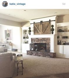 Image result for built in cabinets next to fireplace with tv
