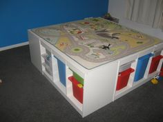 Good idea for a kids play room. home made type of train table. Or even cover with a piece of wood to create a flat play area. Home Daycare Rooms, Playroom Design, Playroom Ideas, Ikea Trofast, Train Table, Lego Room, Play Table, Home Learning, Kid Spaces
