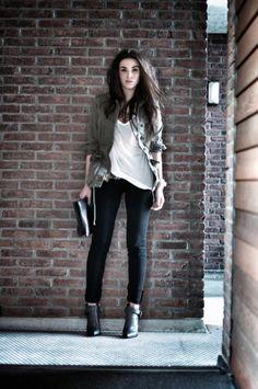Utility jacket, white tee, black skinny jeans.