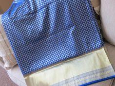 http://www.bonanza.com/listings/Feroze-Blue-Dehera-Silk-Katan-saree-with-ZARI-WORK/381191032 Look sensuous in this lustrous Royal Blue banarasi Dehera silk katan with all over hand woven zari butis. The majestic gold border and pallu have heavy gold zari weave. This bridal hue comes with a royal blue blouse material.