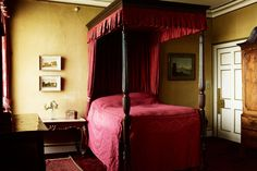 "[i]Antique four poster bed with red bedding and matching rug.[/i]  Like this? Then you'll love  [link url=""http://www.houseandgarden.co.uk/interiors/interior-design-ideas-small-spaces-flats""]Small Spaces, Huge Inspiration[/link]"