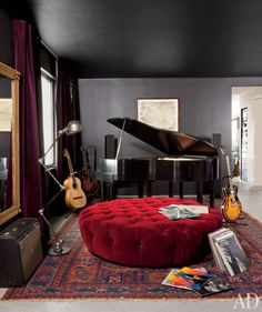 piano, guitar, red tufted ottoman
