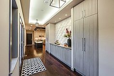 """Smart and stylish floor to ceiling storage... so your guests only see """"wow"""" coming in the front door and not a pile of coats, shoes and backpacks."""