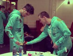 Liam and Zayn smacking each other in the goods with paint. typical.
