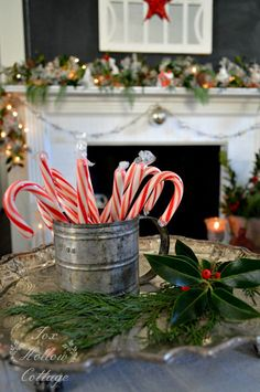 Simple budget Christmas decor in black white and red with lots of candy canes and natural greens (free from the yard!)