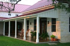 country houses with big porches - Like the porch supports, very simple, love the stained concrete. Stained wood door.