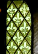 Fleur-de-lis stenciled on stained glass -- Annunciation Church, Buffalo