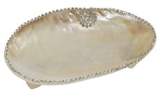 Clam Shell Dish – Pearlized river clam with pearl shell feet which is then hand embellished by our artisans around the rim with crystals – Perfect for any room of the home. Our products are natural and as such there may be variations in color and size.