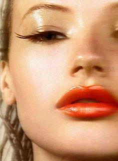 Dewey skin, glossed eye, orange glossy lip