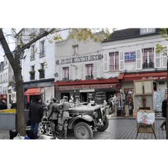"""Paris, 1940, Montmartre    Paris, 1940, Montmartre. German troops outside a restaurant learning against a Sd.Kfz. 10. The Sd.Kfz was a German half-track that saw widespread use in WWII. Its main role was as a prime mover for small towed guns. German soldiers were ordered to behave correctly and courteously to the Paris population, and were usually careful enough to pay for everything they bought, though vendors routinely overcharged German soldiers. All prints are sizes 8"""" x 12"""" (20cm x…"""