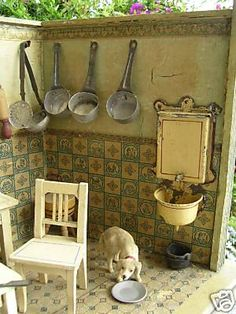 German kitchen with nice enamel fountain. Wonder if we could use a plastic bottle cap for the basin.