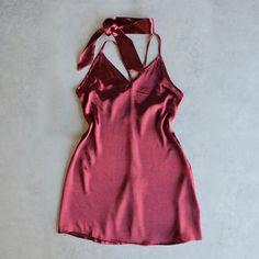 - 100% poly - Hand wash cold - Unlined - Adjustable crisscross shoulder straps - Back hidden zipper closure