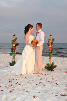 affordable beach wedding packages with decorated tiki torches for any budget