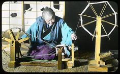 A hand spinning wheel used by an old woman for winding a spool  Enami Studio Lantern Slide No : 642.  About 1920's, Japan